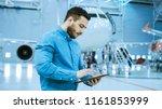 in big company hangar aircraft... | Shutterstock . vector #1161853999