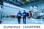 two aircraft maintenance... | Shutterstock . vector #1161854086
