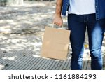 young man holding shopping bag... | Shutterstock . vector #1161884293