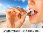beautiful girl eat gum | Shutterstock . vector #1161889183