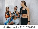 three women in fitness clothes... | Shutterstock . vector #1161894400