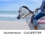 unidentified man riding horse... | Shutterstock . vector #1161895789