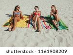 three girlfriends sitting on... | Shutterstock . vector #1161908209