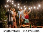 group of young men and women... | Shutterstock . vector #1161930886