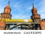 yellow train passing over... | Shutterstock . vector #1161932890