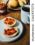 cup of black tea with red jam...   Shutterstock . vector #1161937273