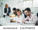 business team working on a...   Shutterstock . vector #1161956023