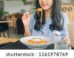 spaghetti on a fork. girl... | Shutterstock . vector #1161978769