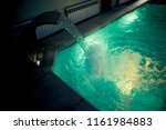the water in the pool inside... | Shutterstock . vector #1161984883
