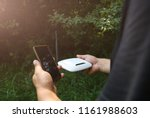 man is looking for wi fi signal ... | Shutterstock . vector #1161988603