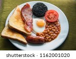 english breakfast with sausage  ... | Shutterstock . vector #1162001020
