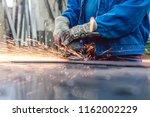 worker in metal factory... | Shutterstock . vector #1162002229