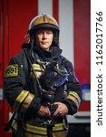 Photo Of Young Fireman Wearing...