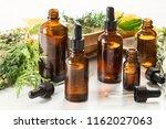 bottles of essential oils.... | Shutterstock . vector #1162027063