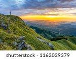 an evocative religious cross on ... | Shutterstock . vector #1162029379
