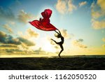 young woman jumping on a beach... | Shutterstock . vector #1162050520
