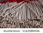 many incense sticks are... | Shutterstock . vector #1162080436