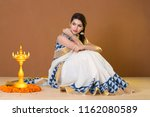 charming young woman wearing... | Shutterstock . vector #1162080589