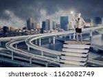a businesswoman standing on a...   Shutterstock . vector #1162082749