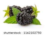 ripe blackberries with green...   Shutterstock . vector #1162102750