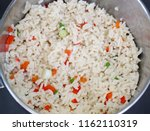 pot of cooked white rice with...