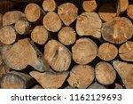 firewood in woodpile  prepared... | Shutterstock . vector #1162129693