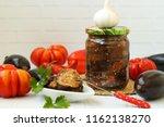 eggplants in acute sauce of... | Shutterstock . vector #1162138270