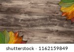 colorful autumn leaves   wooden ...   Shutterstock . vector #1162159849