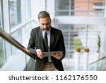 portrait of handsome senior... | Shutterstock . vector #1162176550