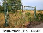 old rusty garden gate  door  on ... | Shutterstock . vector #1162181830