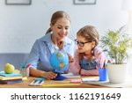 mother and child daughter doing ... | Shutterstock . vector #1162191649