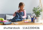 a funny child  girl  doing... | Shutterstock . vector #1162200436