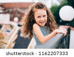 portrait of smiling curly funny ... | Shutterstock . vector #1162207333