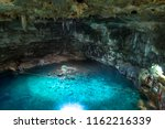 cenote samula in valladolid | Shutterstock . vector #1162216339
