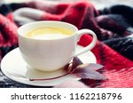 cup of tea with lemon and warm... | Shutterstock . vector #1162218796