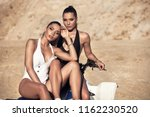 two sexy female twins posing in ... | Shutterstock . vector #1162230520