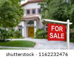 real estate sign in front of new | Shutterstock . vector #1162232476