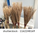 a pile of bamboo brooms in... | Shutterstock . vector #1162248169