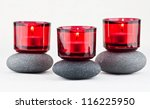 Spa Stones And Candles On White