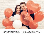 happy couple posing with...   Shutterstock . vector #1162268749