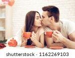 guy and girl drinking tea in...   Shutterstock . vector #1162269103