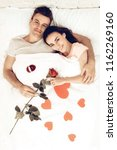 happy couple are lying in bed...   Shutterstock . vector #1162269160