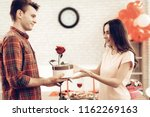 guy makes a gift to girlfriend...   Shutterstock . vector #1162269163