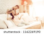 guy makes a gift to girlfriend...   Shutterstock . vector #1162269190
