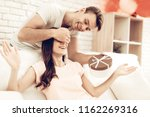 guy makes a gift to girlfriend...   Shutterstock . vector #1162269316