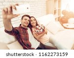 a couple are making a selfie on ... | Shutterstock . vector #1162273159