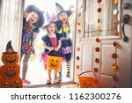 happy halloween  three cute... | Shutterstock . vector #1162300276