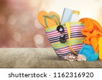bag  sunglasses  on a tropical ... | Shutterstock . vector #1162316920