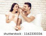 guy feeds girlfriend with sweet....   Shutterstock . vector #1162330336