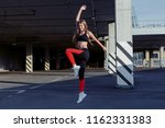 sportswoman jumping and... | Shutterstock . vector #1162331383